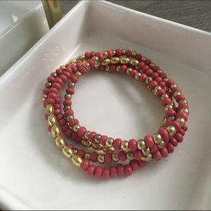 Jewelry - Set of 4 pink/gold bracelets